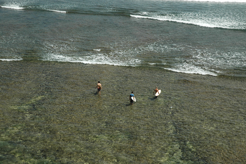 Surfers at Blue Point, Uluwatu, Bali
